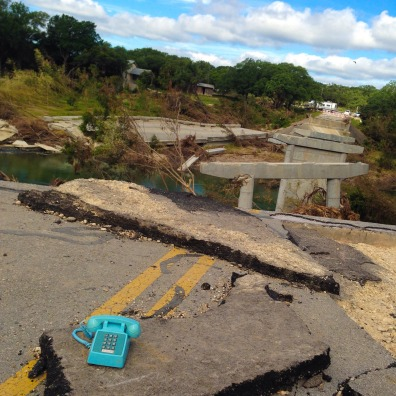 This is another photo of the destruction. This bridge was completely lifted and moved by the force of the water.